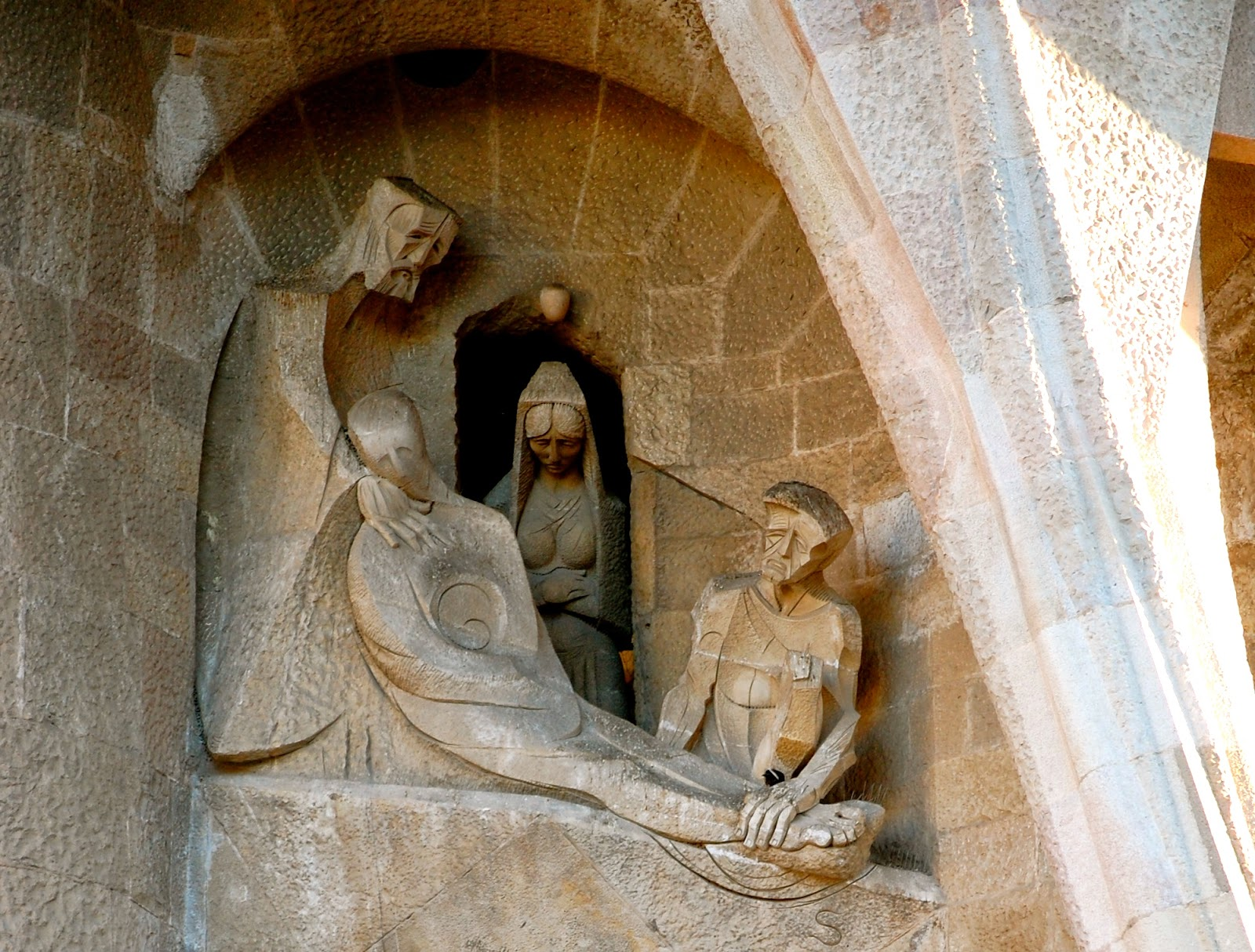 Jesus is prepared for burial by Joseph of Arimathea and Nicodemus on the Passion Facade