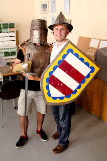 Photo of Simone and Sorin with medieval arms