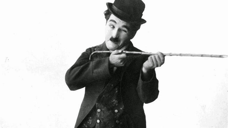 "Contoh Describe About Person, idol, ""Charles Chaplin"""
