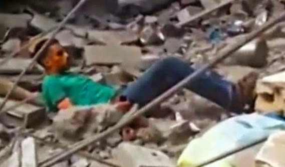 Palestinian Civilian Searching Rubble for Family Members is Murdered by Israeli Troops (WARNING: Graphic Video -Photo screen captured from video)