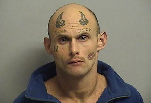 Man With 'F--K Cops,' Horns & Nazi Symbol Tattooed On Face Is Arrested For Robbery