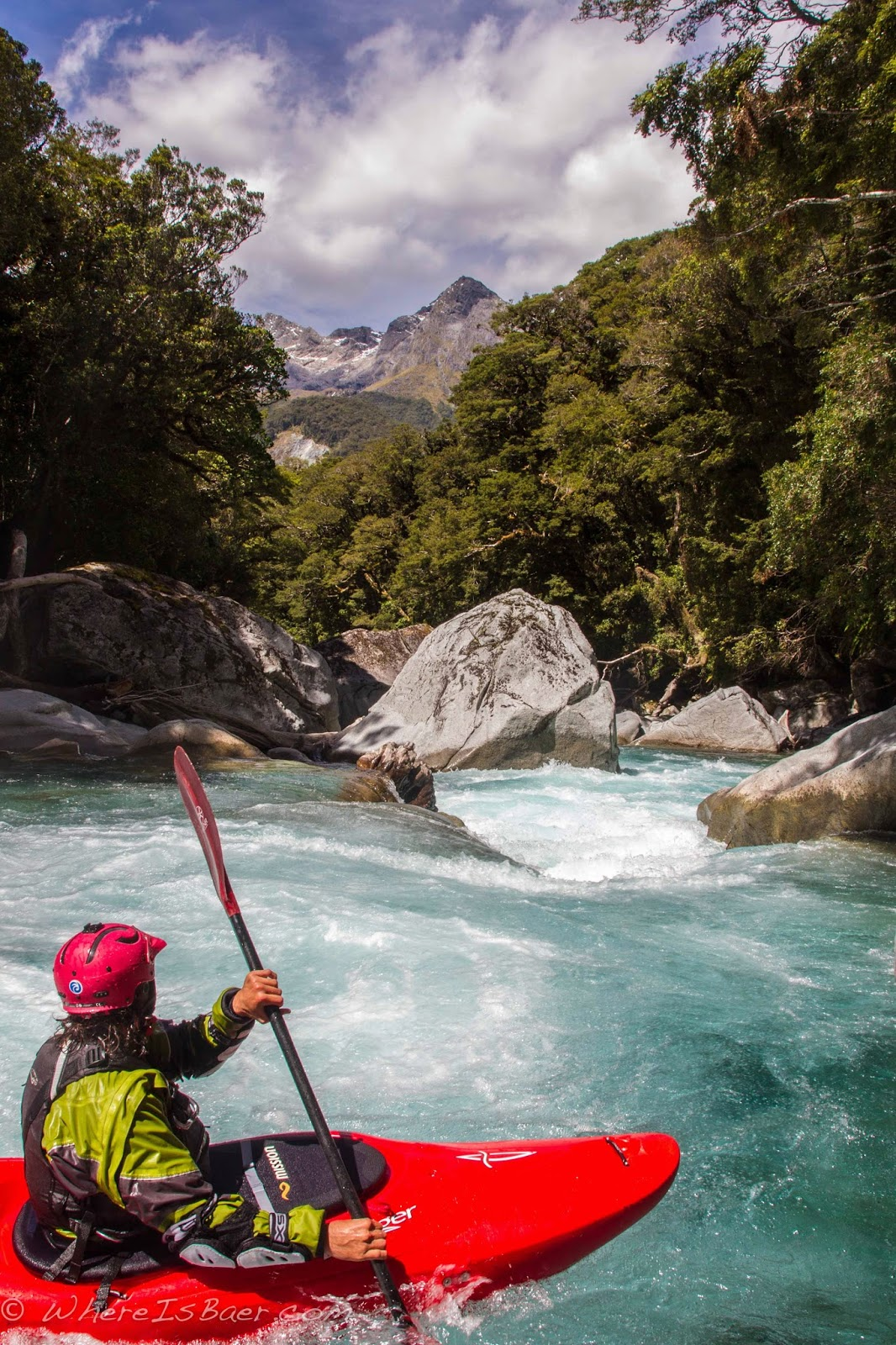 Gonzo spotting his next line on the Hollyford River, NZ, Chris Baer