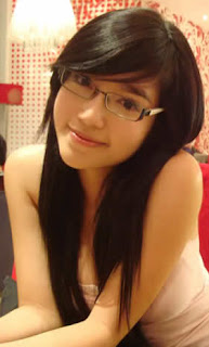 Elly with her eyeglasses