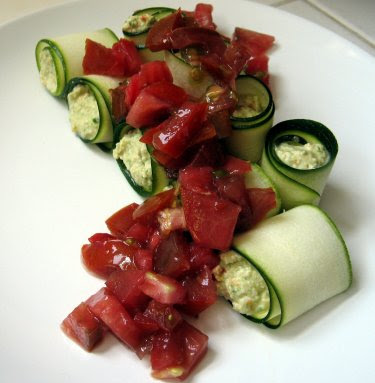 Raw zucchini rolls with cashew cheese and heirloom tomato