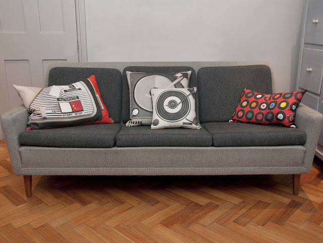 Ella Doran PorTable cushions and Sevens Red cushion in sofa