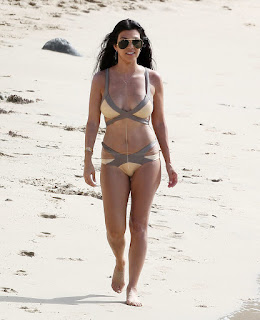 On Thursday, August 20, 2015, the stunning brunette strolled to the beach which skillfully in a brown bikini at the French Island of St Barthelemy with sister, Kendall Jenner.
