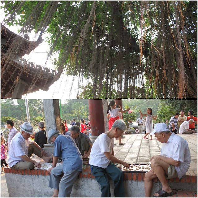 It's breezy watching some elderly people playing chess in the courtyard of Ngoc Son Temple on Jade Island of Hoan Kiem Lake in Hanoi, Vietnam