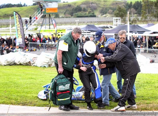 Melanie Oughton, Hawke's Bay, being helped from the track by St John Ambulance and others, after an incident in the Rotax light class - Blossom 47, Lightning Race Gear 47th annual Blossom Sprint Race Meeting, at Kartsport Hawke's Bay CHEMZ Raceway at Roy's Hill, Hastings  photograph