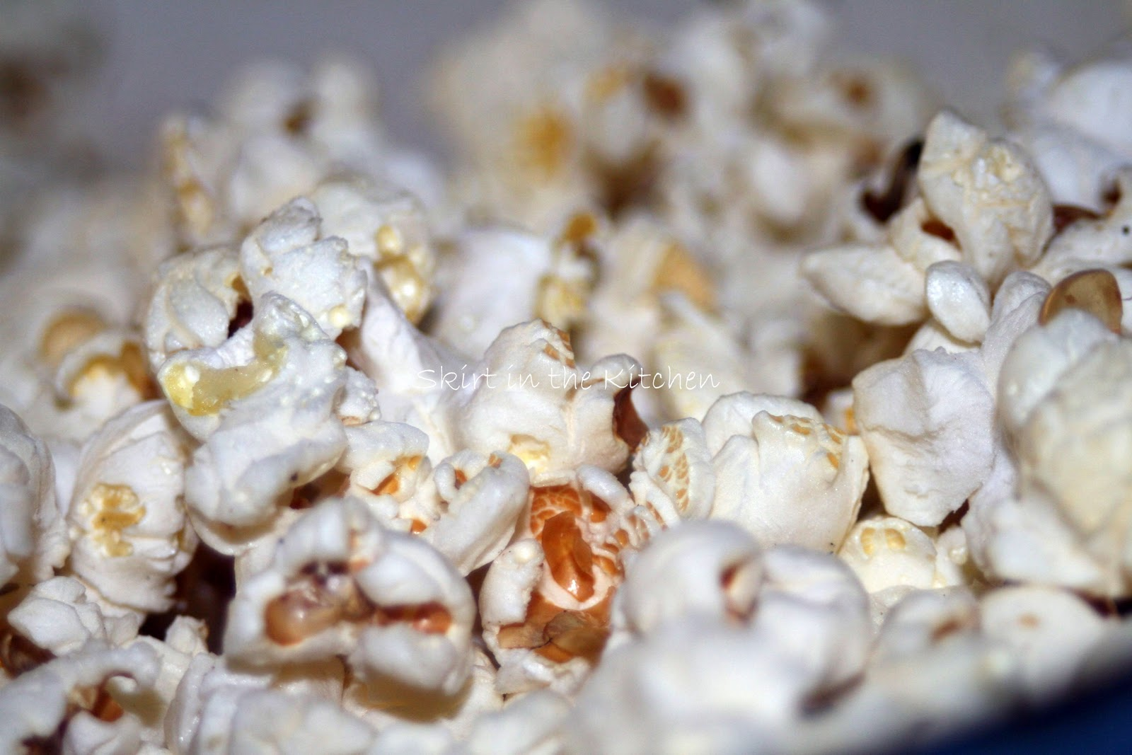 In a large Dutch oven, pop 1/2 cup popcorn kernels in the ...