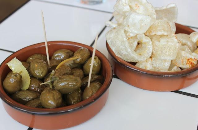 A picture of OAKS Restaurant Nottingham Pork Crackling and Baked Olives, Garlic & Rosemary