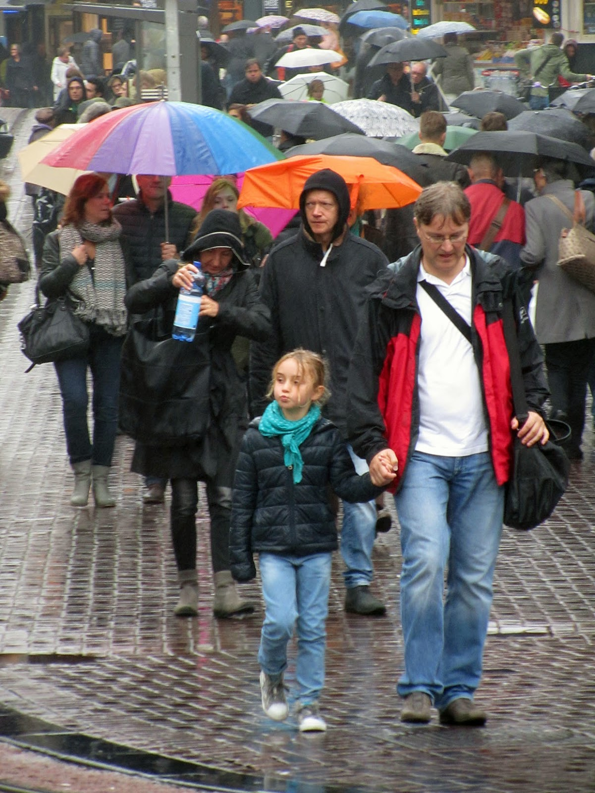 lots of people in the rain