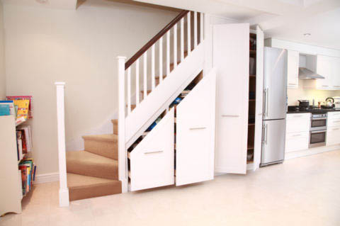 15 creative and clever under stair storage designs for Stair cabinet design