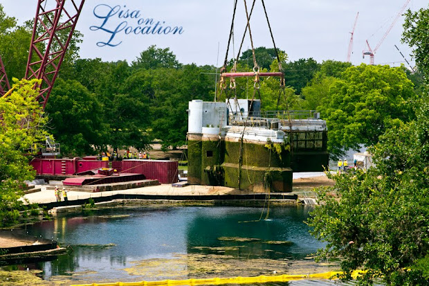 The 400-ton Submarine Theater is lifted out of Spring Lake at Aquarena Center, Texas State University-San Marcos. Photo by Lisa On Location photography.