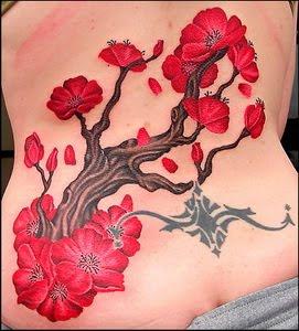cherry blossom lower back feminin tattoo for girls
