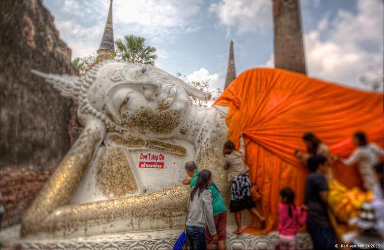 Robing a Buddha statue