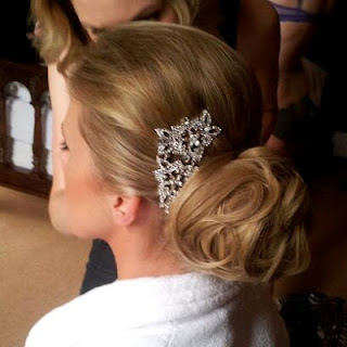 Textured wedding bun with bridal hair piece