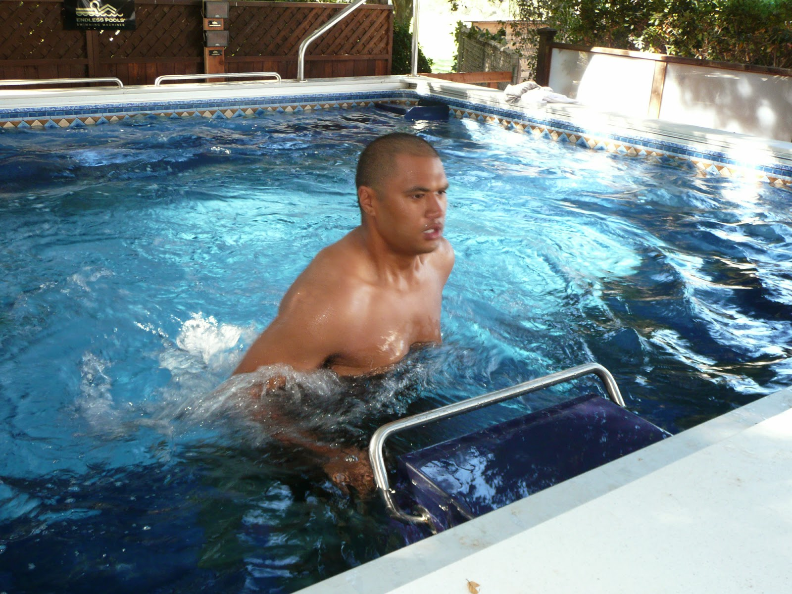 Sam Poueu, a contestant on The Biggest Loser, Season 9, runs on the underwater treadmill of the ranch's Dual-Propulstion Endless Pool.