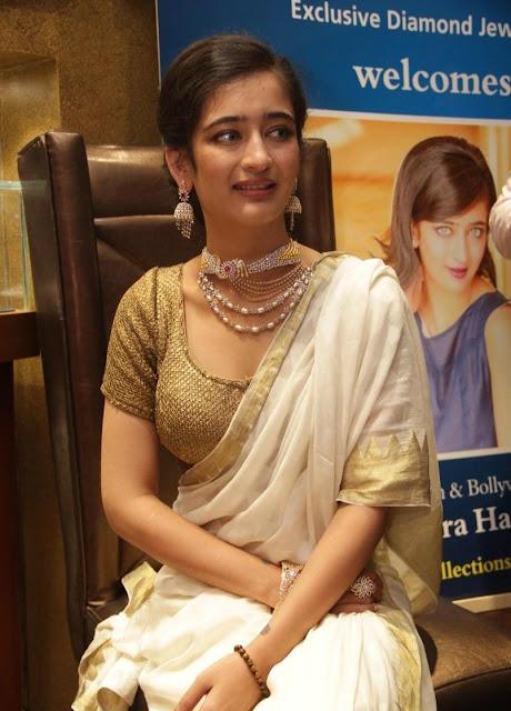 Akshara Haasan in a Golden Choli Blouse and Cream Saree at a Diamond Showroom Launch in Chennai