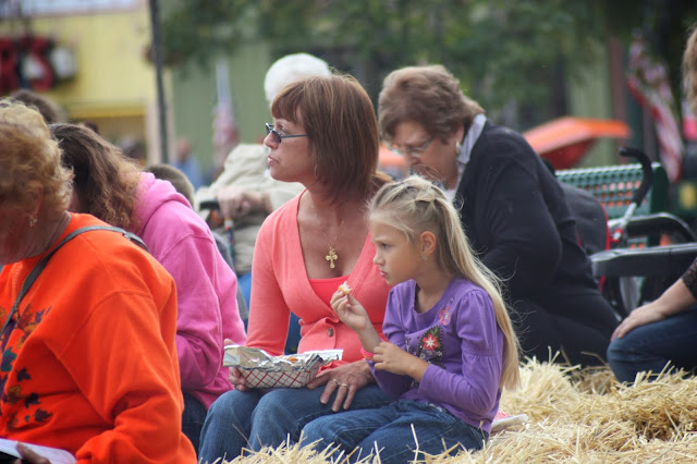 Woman and daughter eating homemade potato chips