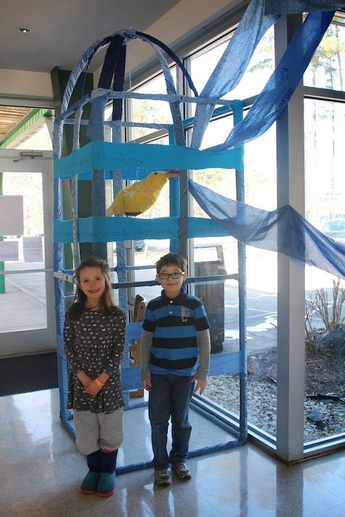 Two River students visit the gym to view their work.