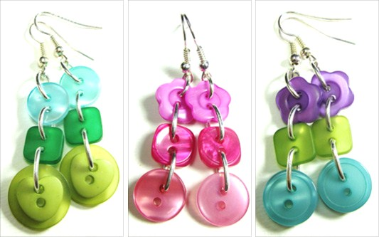 Flattering drop dangle earrings have 3 colorful buttons linked in long strand