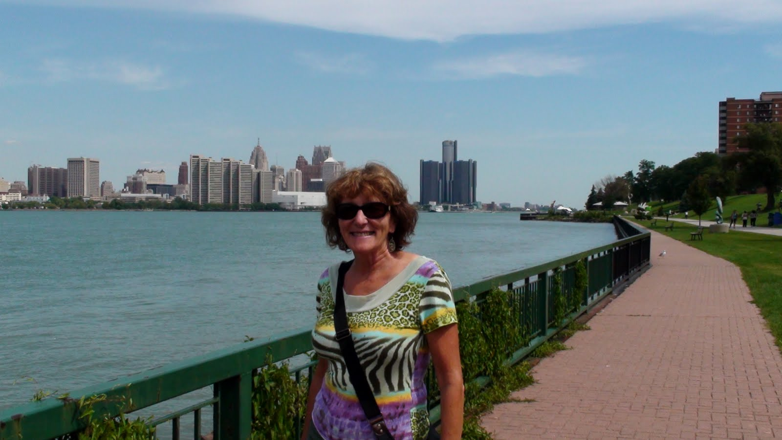 Liz in Winsdor Ontario looking across the Detroit River to Detroit, Michigan, USA.