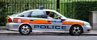 Police bandnaam herkomst - Met police car