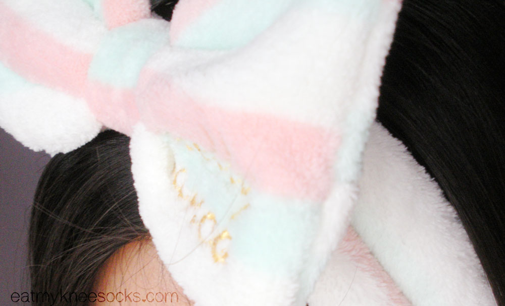 The lovely soft butterfly bow headband from Love Shoppingholics is made from a warm, fluffy fleece-like material.