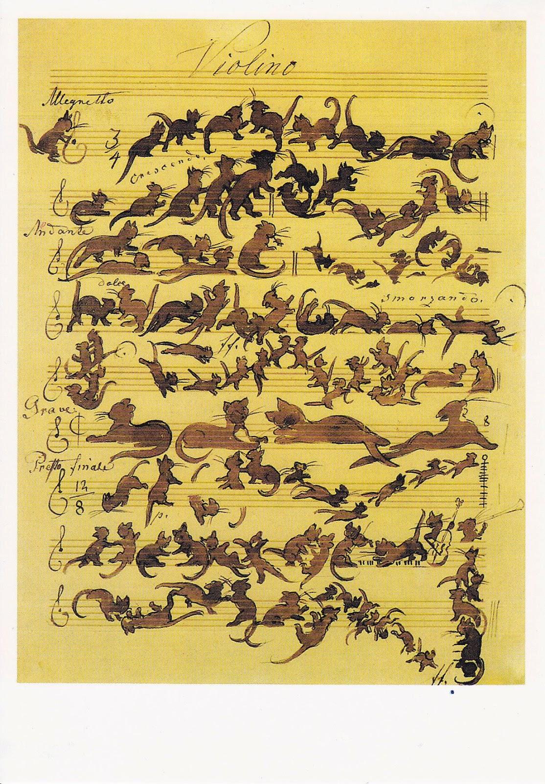 Katzen purzeln über ein Notenblatt