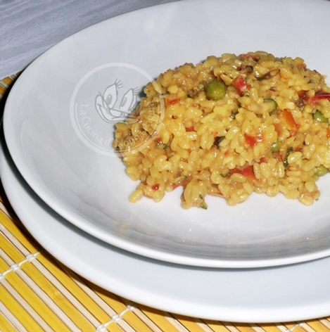 paella valenciana con pesce e verdure
