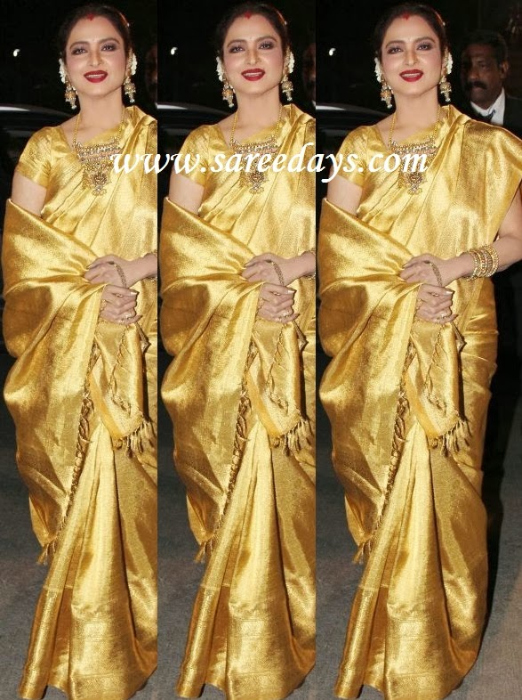 Latest saree designs rekha in gold colour kanchipuram silk saree checkout rekha in gold colour kanchipuram silk saree with rich self zari work and paired with matching short sleeves blouse altavistaventures Image collections