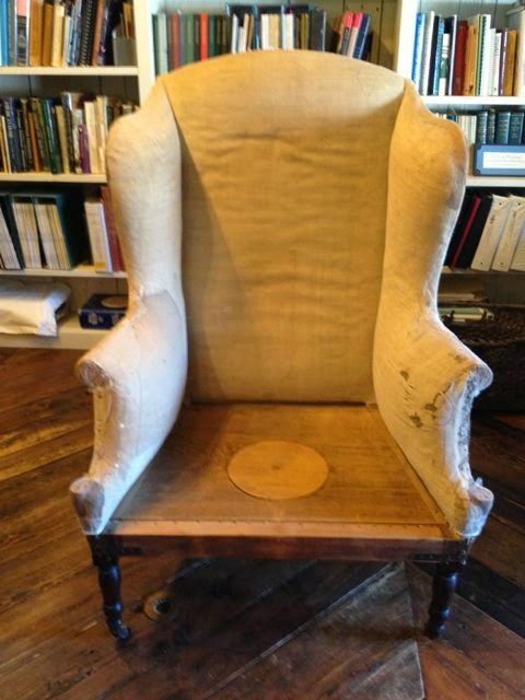 Reupholstery of historic furnishings is expertly done at Spicer Art Conservation. Before image of chair.