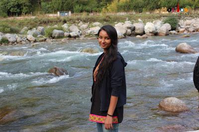 Kriti posing in a beautiful backdrop