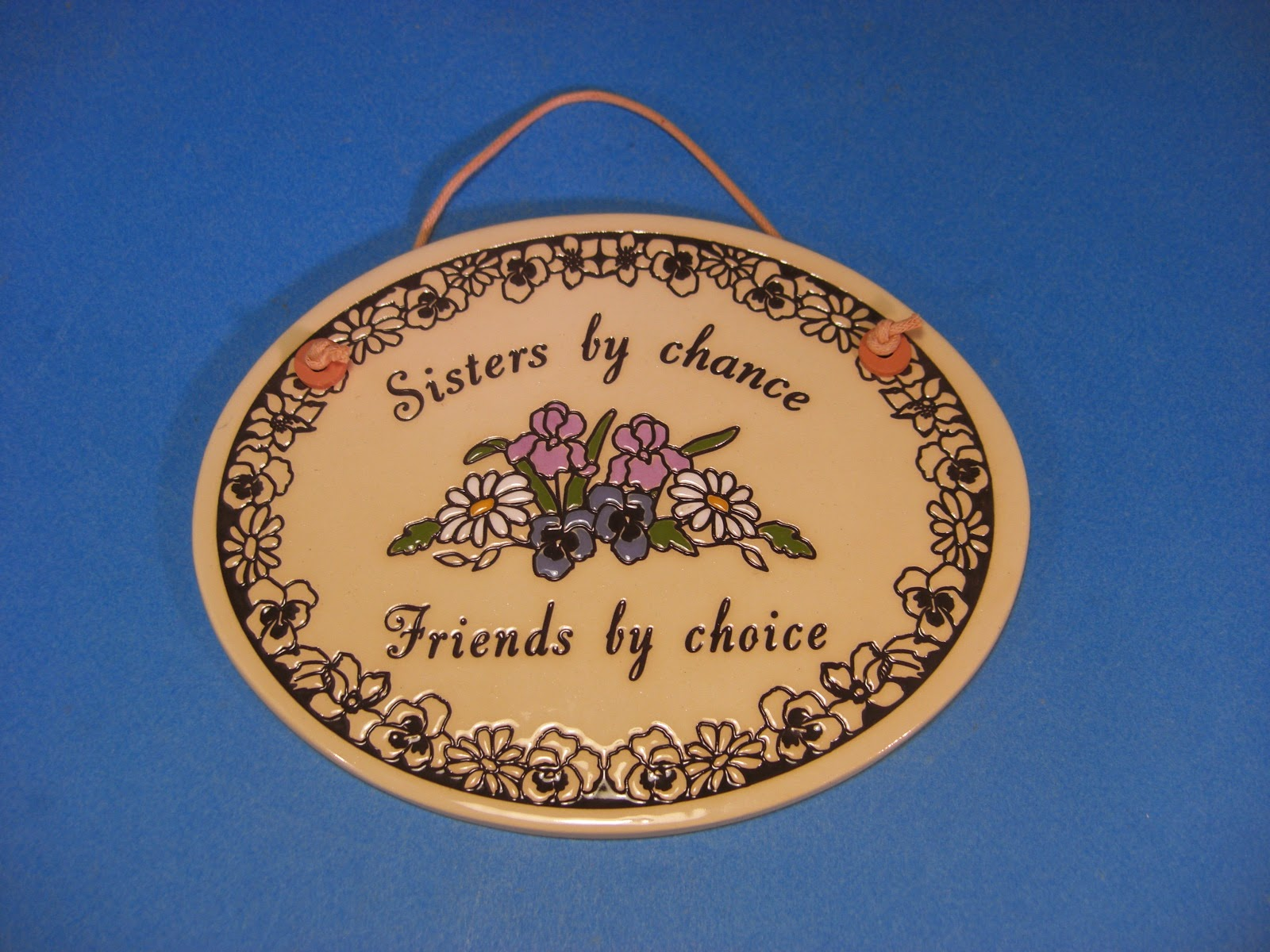 http://www.bonanza.com/listings/Trinity-Pottery-Made-in-the-USA-Ceramic-Wall-Plaque-Sisters-by-Chance-Friends-by/246446836