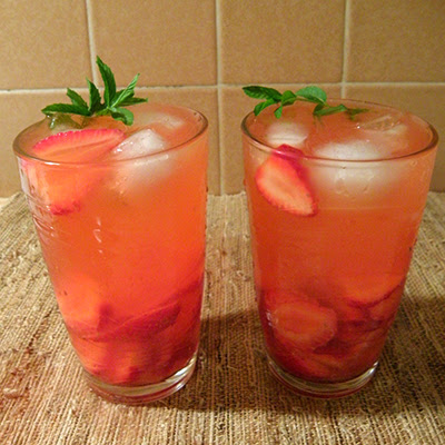 Two Glasses of Strawberry Lemonade with Mint Sprigs