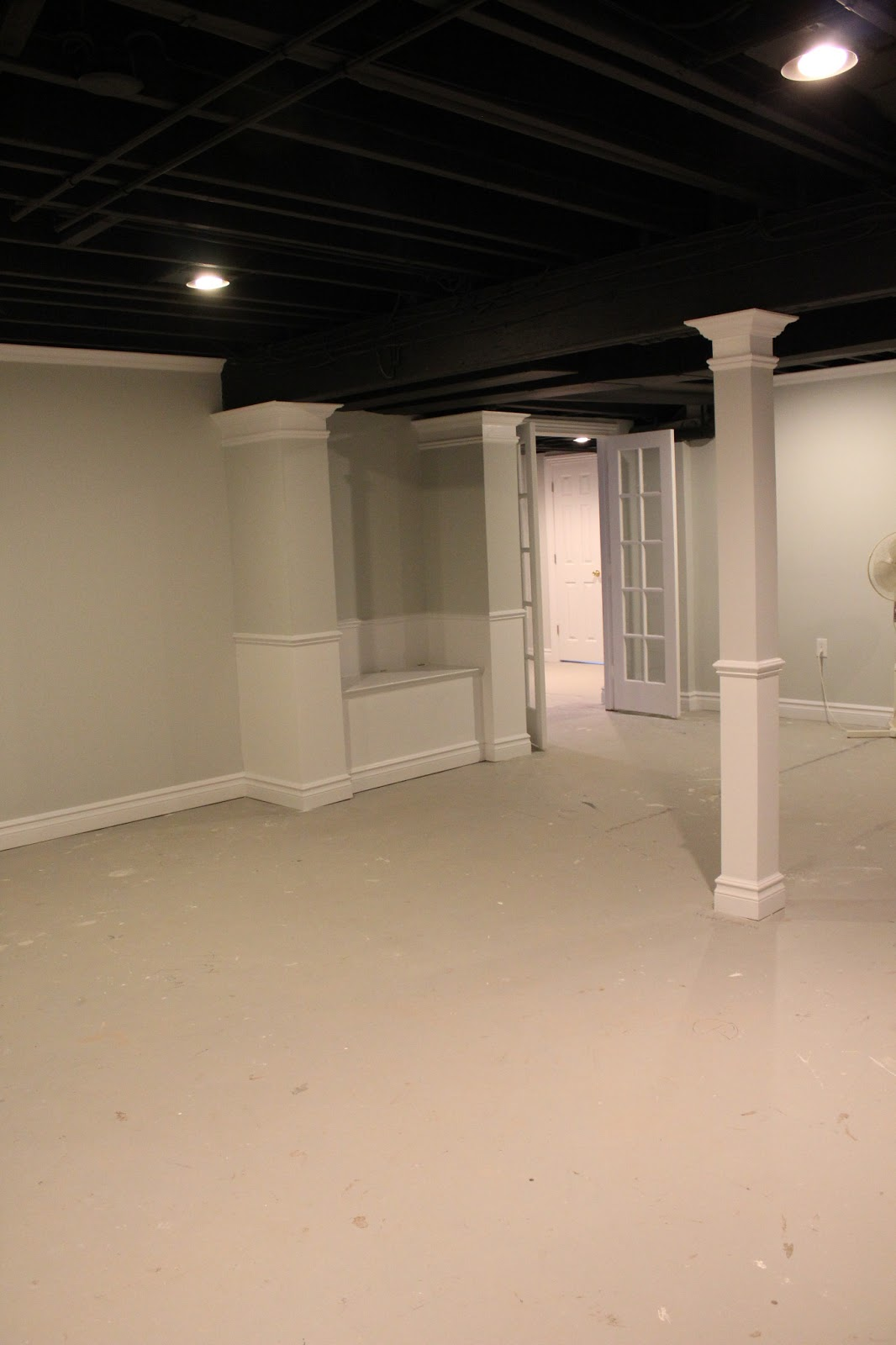 basement remodel with painted exposed ceiling. Black Bedroom Furniture Sets. Home Design Ideas