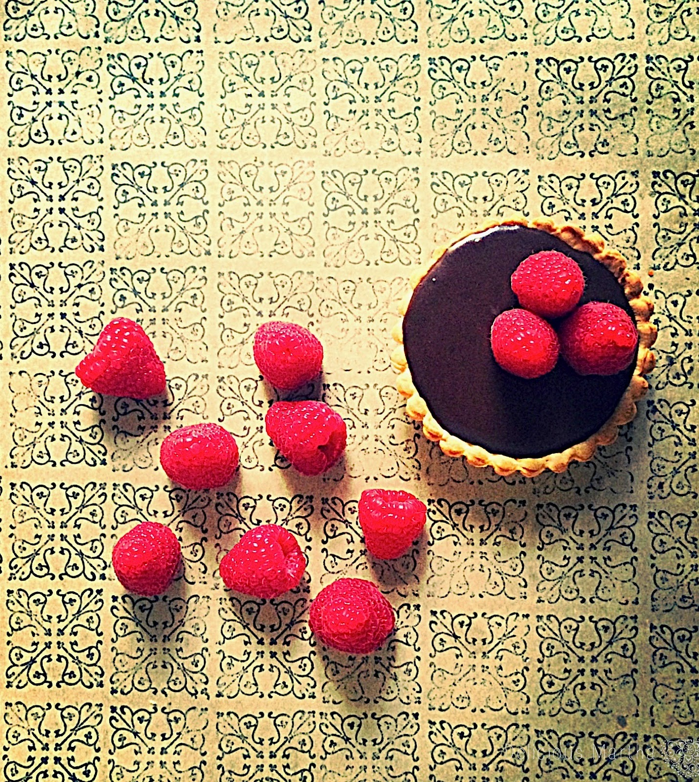 Tartaletas de chocolate con mermelada de frambuesa y cacao Can Bech