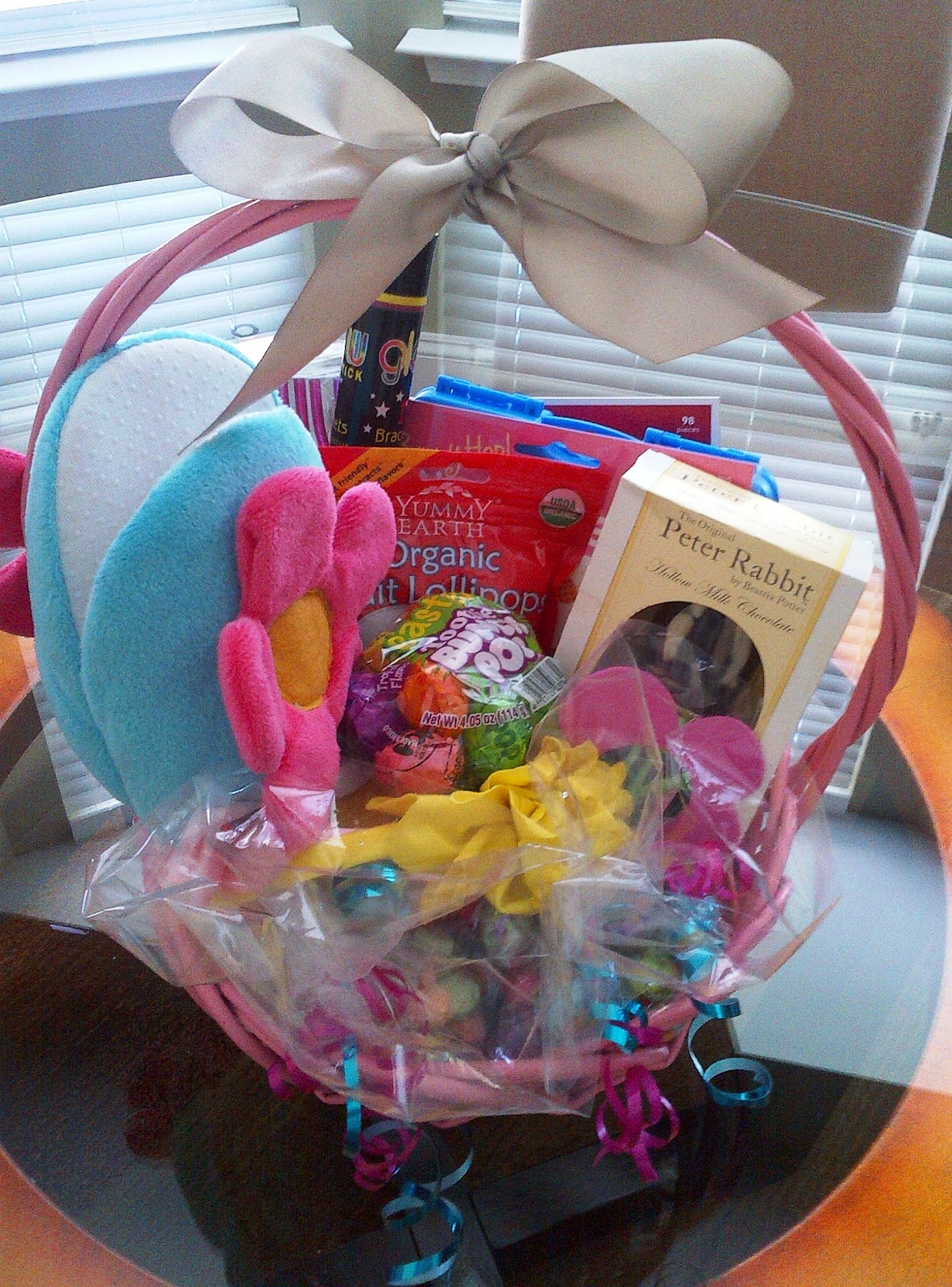 Personalized solutions the perfect easter basket gift basket the 7 year old girls basket we have flower slippers lollipops silly straws a chocolate bunny two headbands candies glow sticks etch a sketch negle