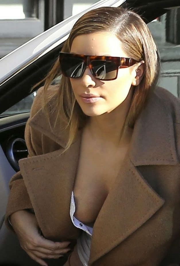 Kim Kardashian big cleavage low cut T-shirt