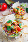 Chipotle Lime Shrimp and Guacamole Dip with Tomatoes and Charred Corn