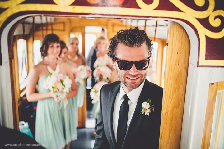 """groom and bridesmaids on cable car in san francisco"""
