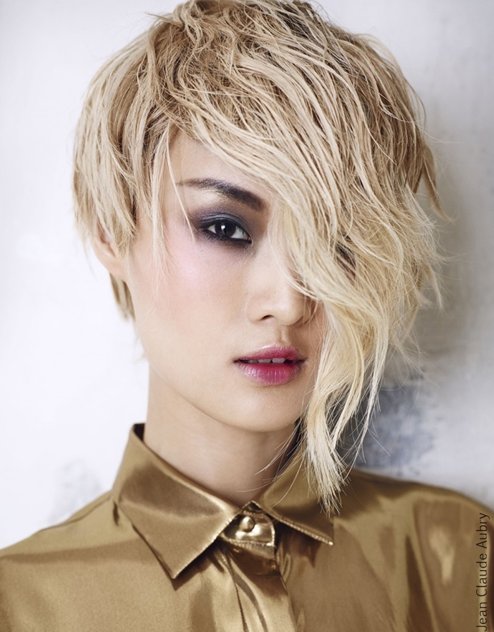 Assymetric blonde haircut hairstyle