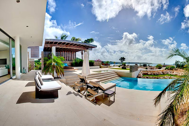 Outdoor furniture by the swimming pool and incredible ocean view