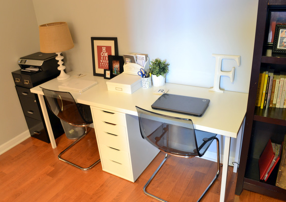 Double Ikea desk and organized office space.