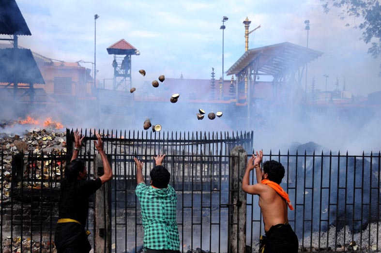 Devotees Throwing Coconuts Into Aazhi Near Sannidhanam At Sabarimala On 16th December 2011