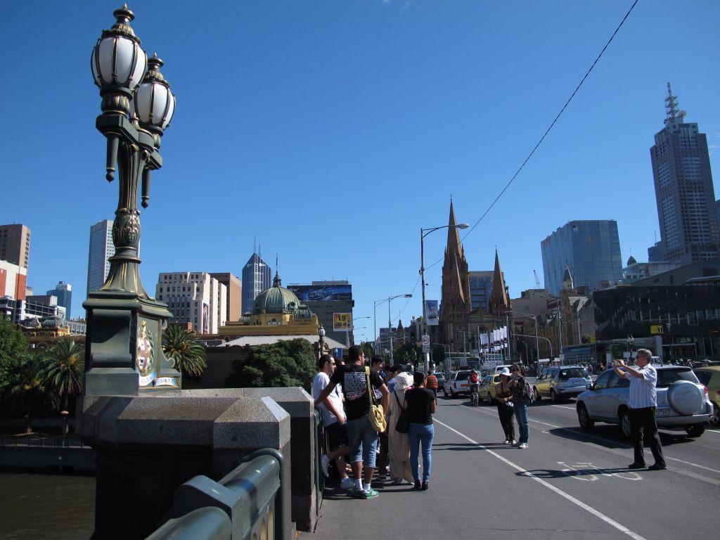 Taking photos on Princes Bridge, Melbourne. Photo by Susan Wellington