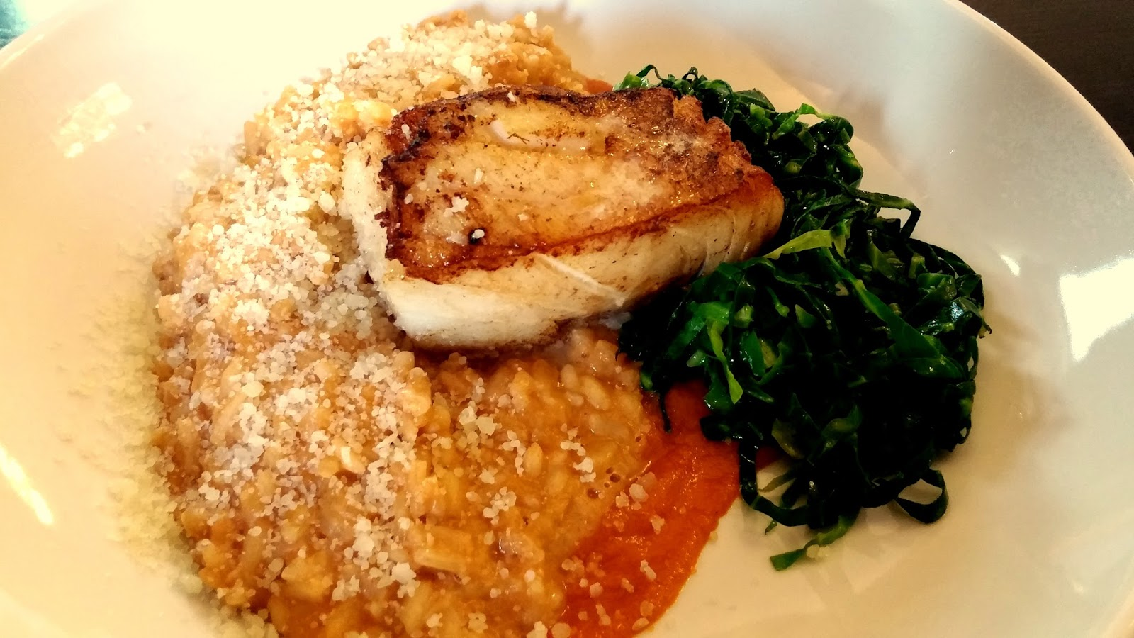 crab risotto with pan fried cod and kale in rich tomato sauce at oak tree restaurant bluestone wales