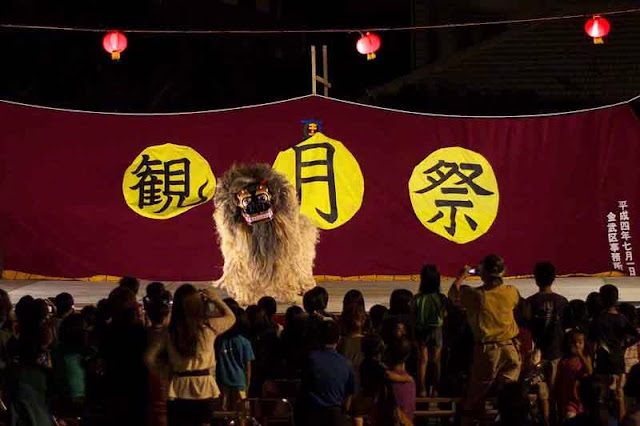 dancing lion dog on stage at full moon festival, harvest moon