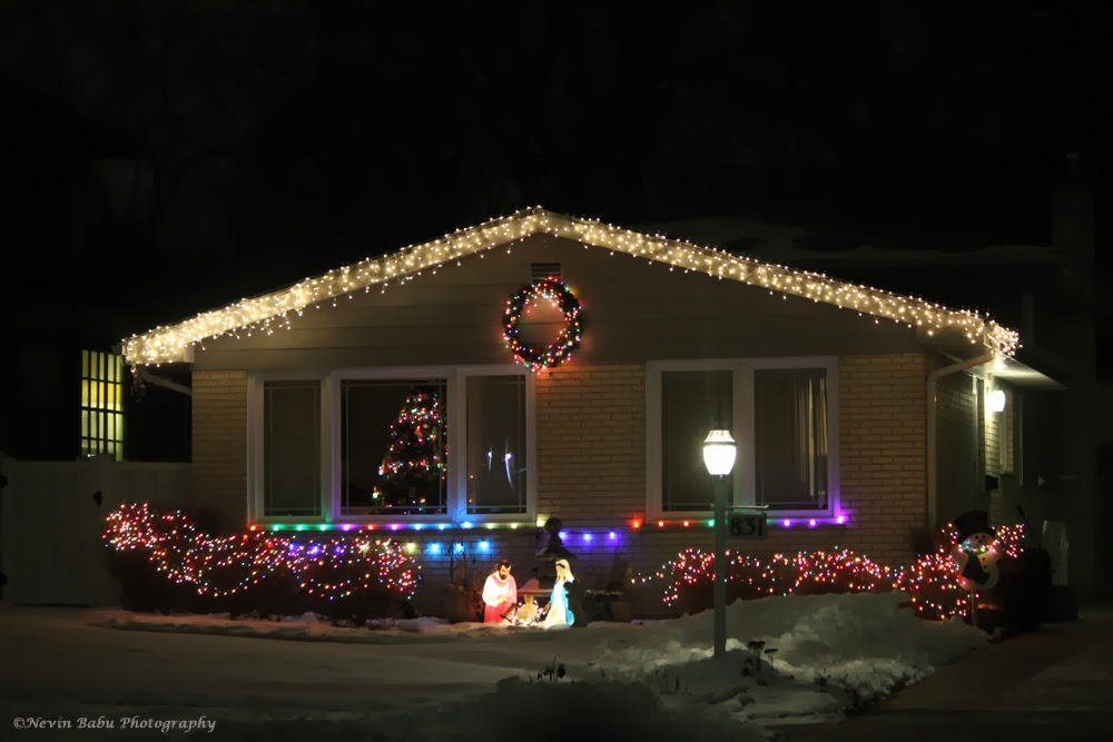 a well decorated house on christmas eve through the lens well maintained well decorated and well located cottage