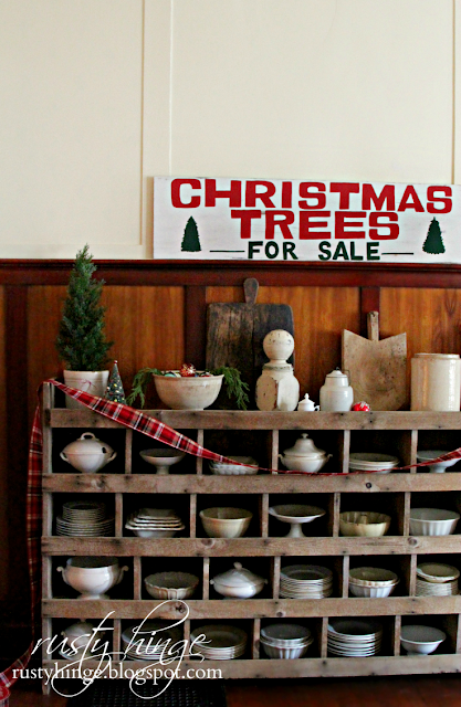 Christmas Trees For Sale sign above chicken nester filled with ironstone